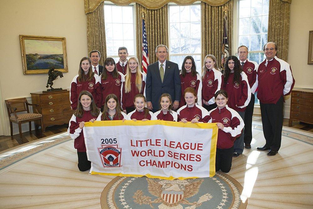 President George W. Bush stands with the 2005 Little League Softball World Series Champions Tuesday, Jan. 10, 2006, in the Oval Office. The McLean, Va., All-Star team represented the South Region and bested six regional championship teams during a week-long tournament in Portland, Ore. Photo by Eric Draper, Courtesy of the George W. Bush Presidential Library