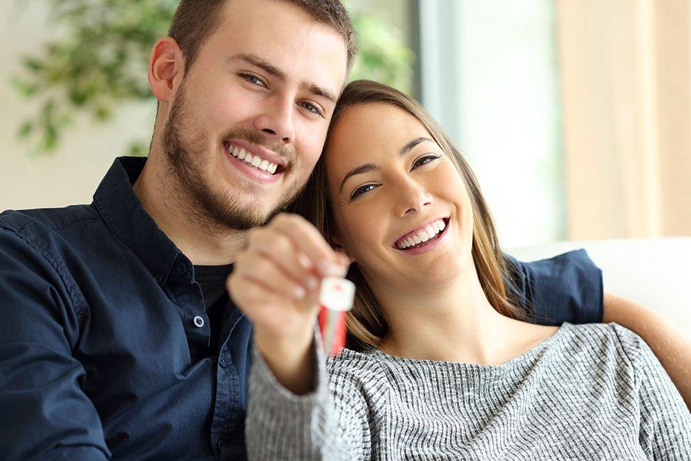 image of couple holding keys