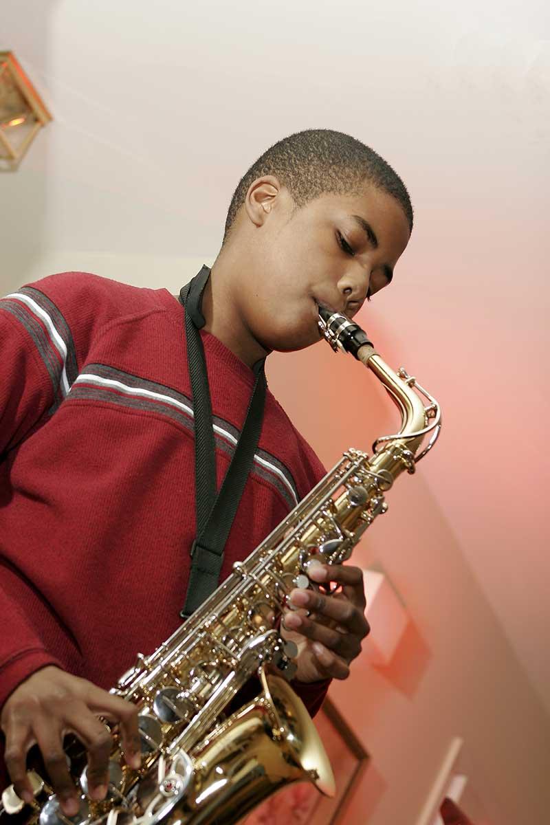 Boy playing saxophone